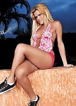 Naughty transsexual Hilda Brazil stripping and posing